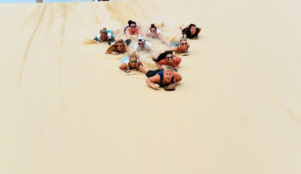Oz-Gap-Year-Australia Gap Year Tour Working Holiday Package in Australia Work and Travel in Sydney and Find Paid Work Down Under-Aussie-Adventure-Sandboarding Port Stephen Grabatour-Travel